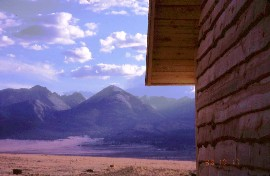 Natural Edge Board lap siding with sangre de cristo mountains in background
