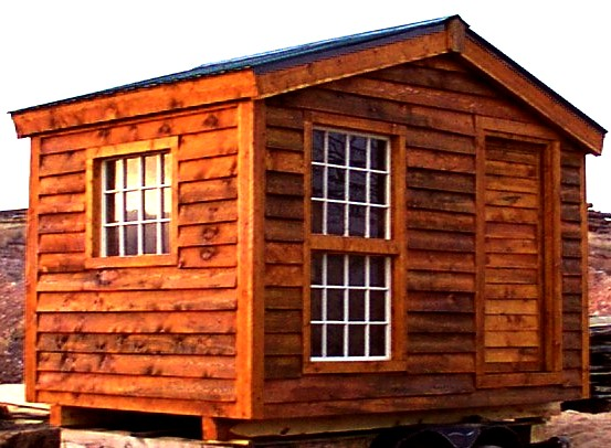 Rough Sawn lap sided shed with reused windows constructed by greenleaf forestry