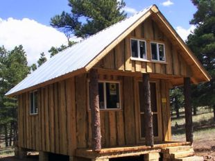Vertical natural board siding plus four foot two window loft cabin