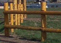 post and log rail fence built by greenleaf forestry craftsmen