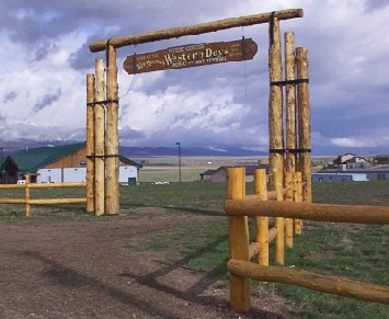 tall log entry way with sign western days built by greenleaf forestry