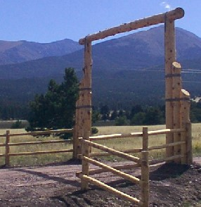 log entry way with pole fence made by greenleaf forestry craftsmen