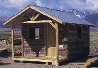 log sided cabin without lofts built by greenleaf forestry craftsmen